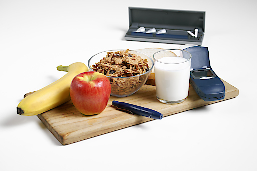 Healthy diabetic breakfast with testing and delivery devices.